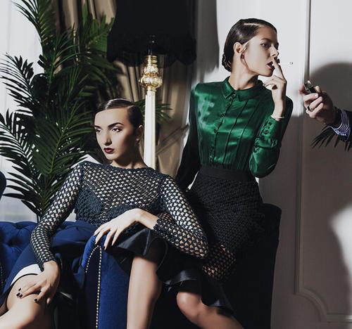 Two women in high fashion clothing