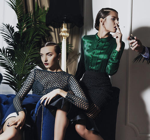 Two women in high fashion clothing