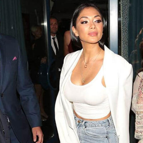 Nicole Scherzinger exhibits cleavage as she celebrates 40th birthday