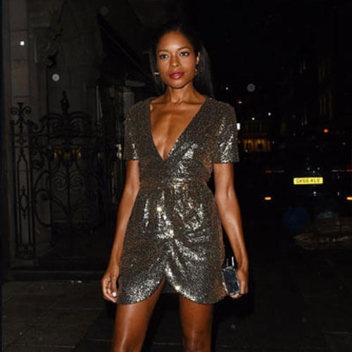 Naomie Harris looks sensational in glittering gold mini dress as she celebrates her 42nd birthday